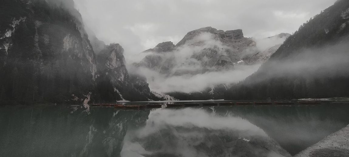 Panoramic view of lake of braies and mountains against sky