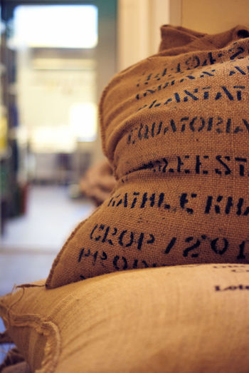 Sacks Of Coffee Fabric Coffee Bokeh Cafe Close-up Doorframe Focus On Foreground Indoors  No People Sack Text