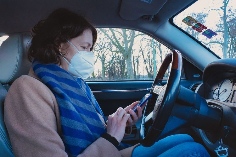 Midsection of woman sitting in car