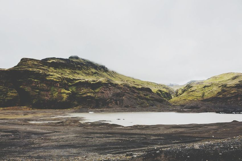Haunting  Mist Winter Cool Cool Tones Lake Dark Mysterious Lonely Isolated Ancient Old North Fantasy Folklore Lakeshore Iceland Green White Dark EyeEm Selects Outdoors Landscape Beach No People Rock - Object Nature Scenics Shades Of Winter An Eye For Travel
