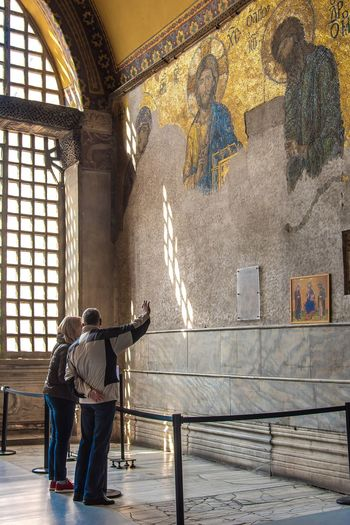 Tourists watching mosaic in Hagia Sophia Cathedral in Istanbul Mosaic Art Museum Turkey Culture Historical Istanbul Hagia Sophia Two People Religion Indoors  Standing Full Length Travel Destinations Architecture