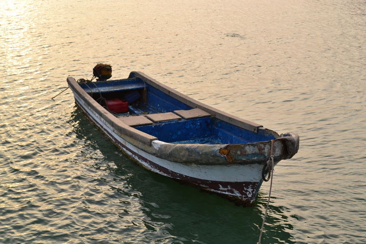 Morning - Mar. 2012 Old-fashioned Tradition Calm Sunrise Seaside Golden Hour Fishing Boat Boat Rowboat Rippled Tranquility Travel High Angle View Moored Outdoors Day Nature Sea Waterfront Mode Of Transportation Transportation Water Senegal Africa Simplicity