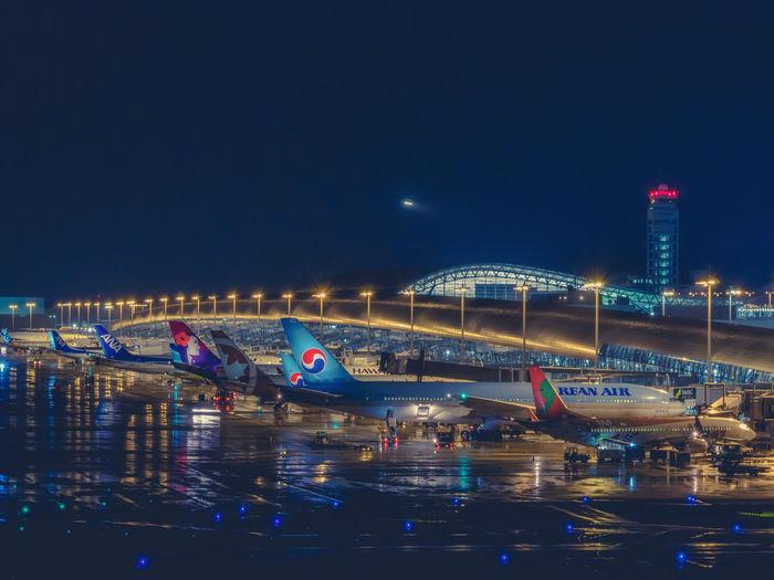 Kansai intl. airport Japan Japan Photography Nightphotography Planespotting Aircraft Airport Blue City Clear Sky Illuminated Kansai International Airport Nature Night No People Outdoors Sky Water
