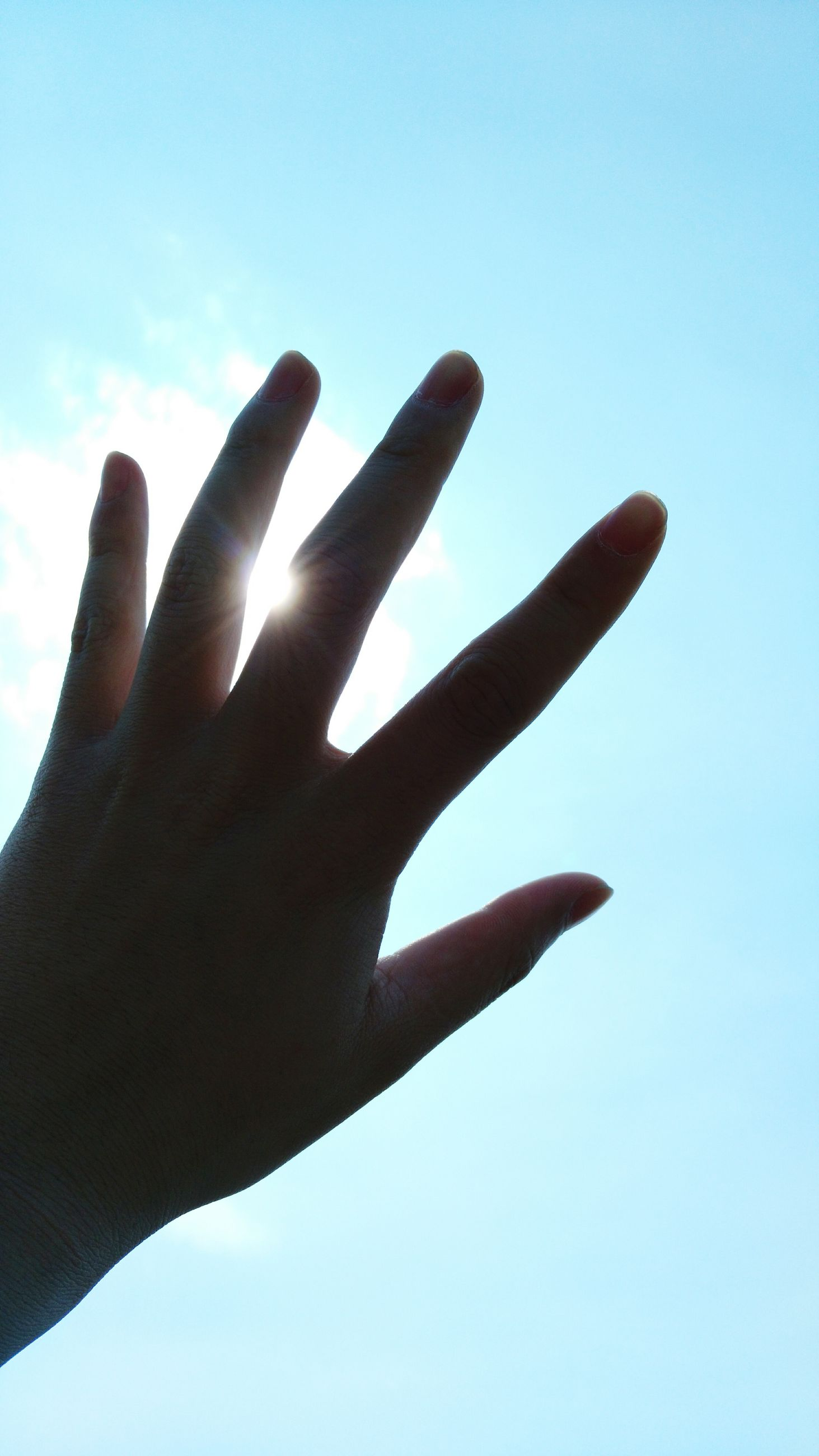 person, part of, cropped, low angle view, human finger, clear sky, sky, close-up, holding, unrecognizable person, blue, copy space, silhouette, outdoors, day, personal perspective, showing