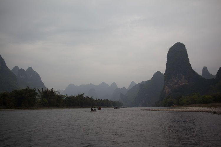 Passenger Boats On River In Mountains