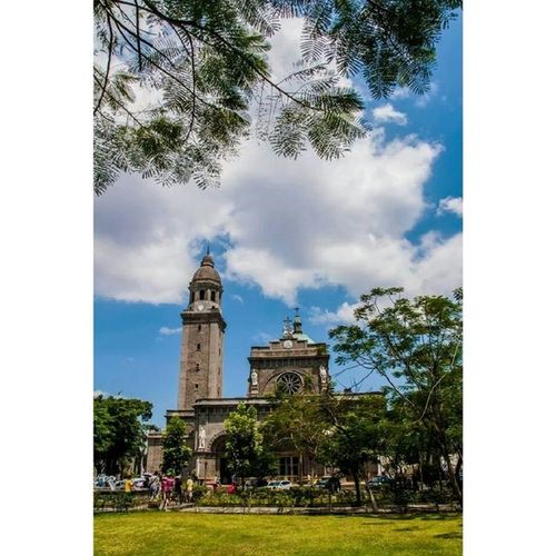 Clouds and sun hide and seek make my trip very special to the historic town of Intramorus SpanishLegacy Pathways Park Trees Church building Archeticture art Cathedral Travel FunDay Walk Clouds Colors Manila historic Philippines ItsMoreFunInPhilippines Holidays