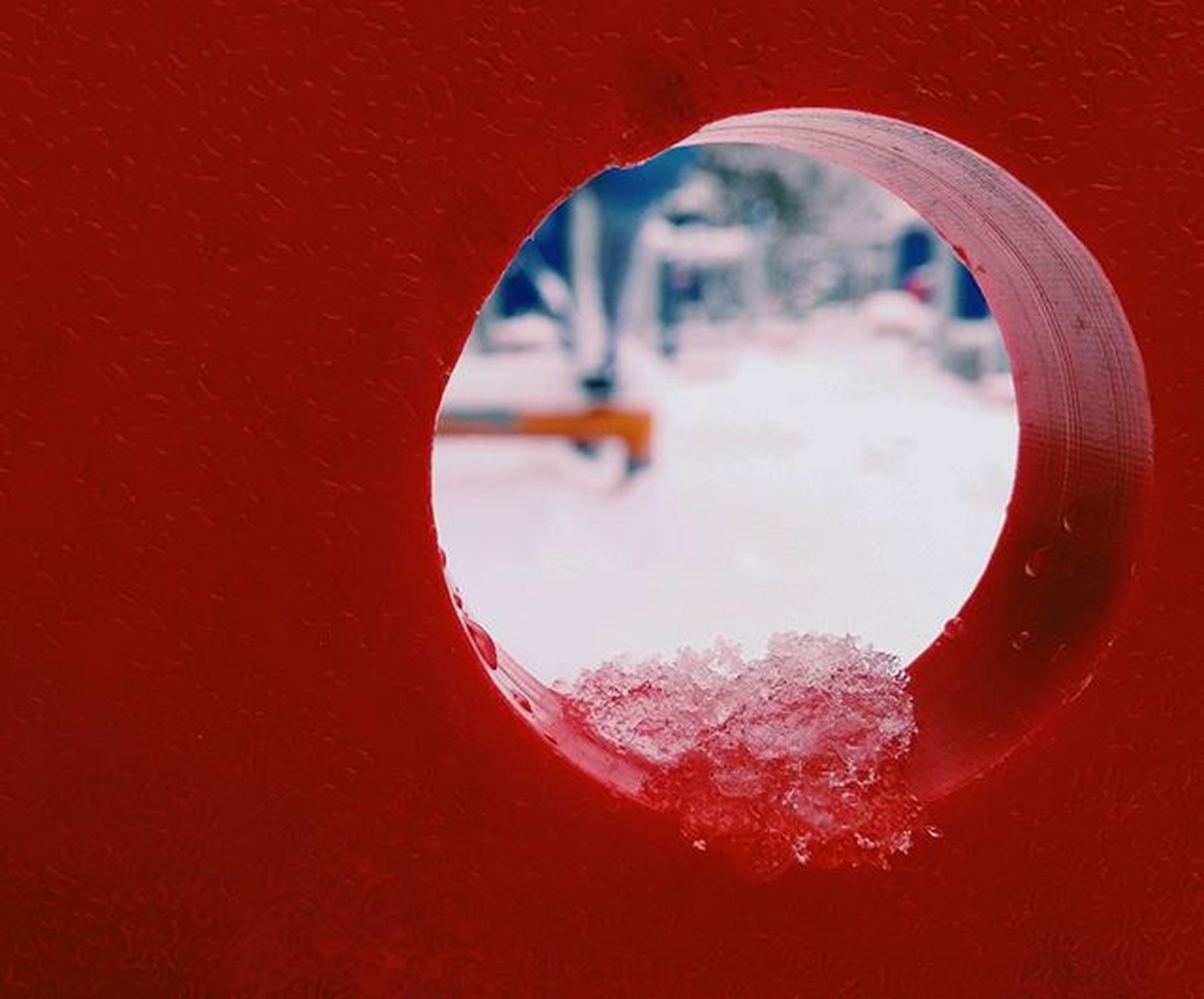 red, close-up, circle, indoors, tree, season, window, focus on foreground, day, water, no people, part of, shape, reflection, rain, hole, sky, geometric shape, transparent