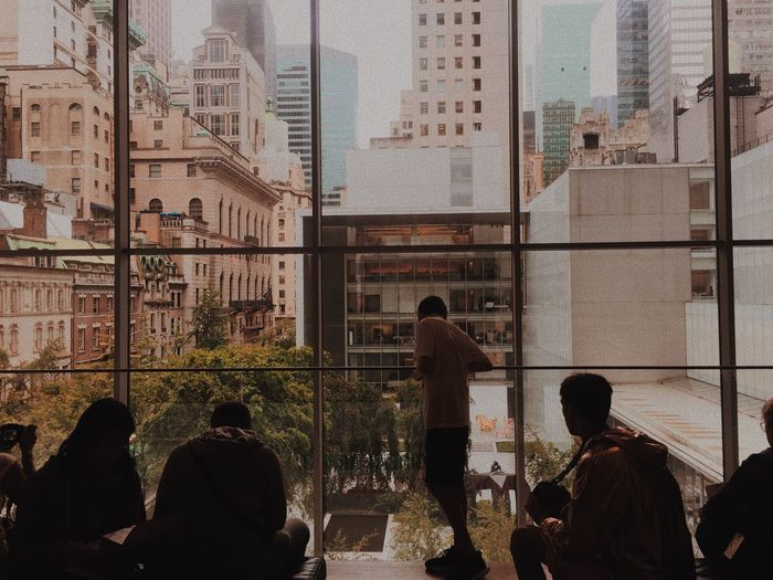 New York City New York Moma Group Of People Real People Architecture Built Structure Window Men People Building Exterior Group Leisure Activity Lifestyles Day Medium Group Of People Building Glass - Material Women Silhouette Outdoors