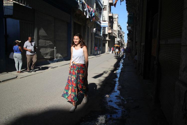 Portrait of woman walking on street in city