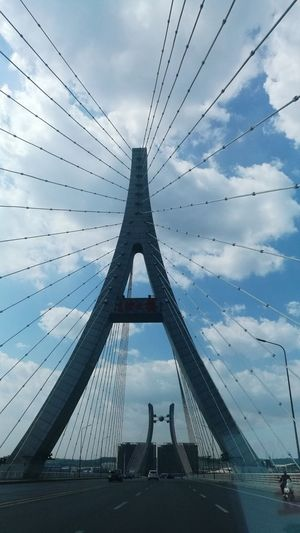 Cloud - Sky Connection Bridge - Man Made Structure Sky Suspension Bridge Architecture Built Structure Travel Destinations Cable Steel Outdoors No People Cityscape City Urban Skyline Day Golf Club