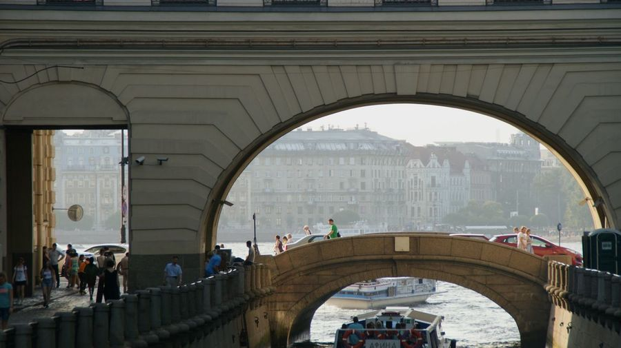 People on bridge in city