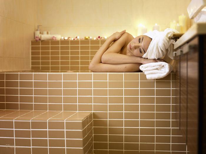 Woman Relaxing In Bathtub At Bathroom