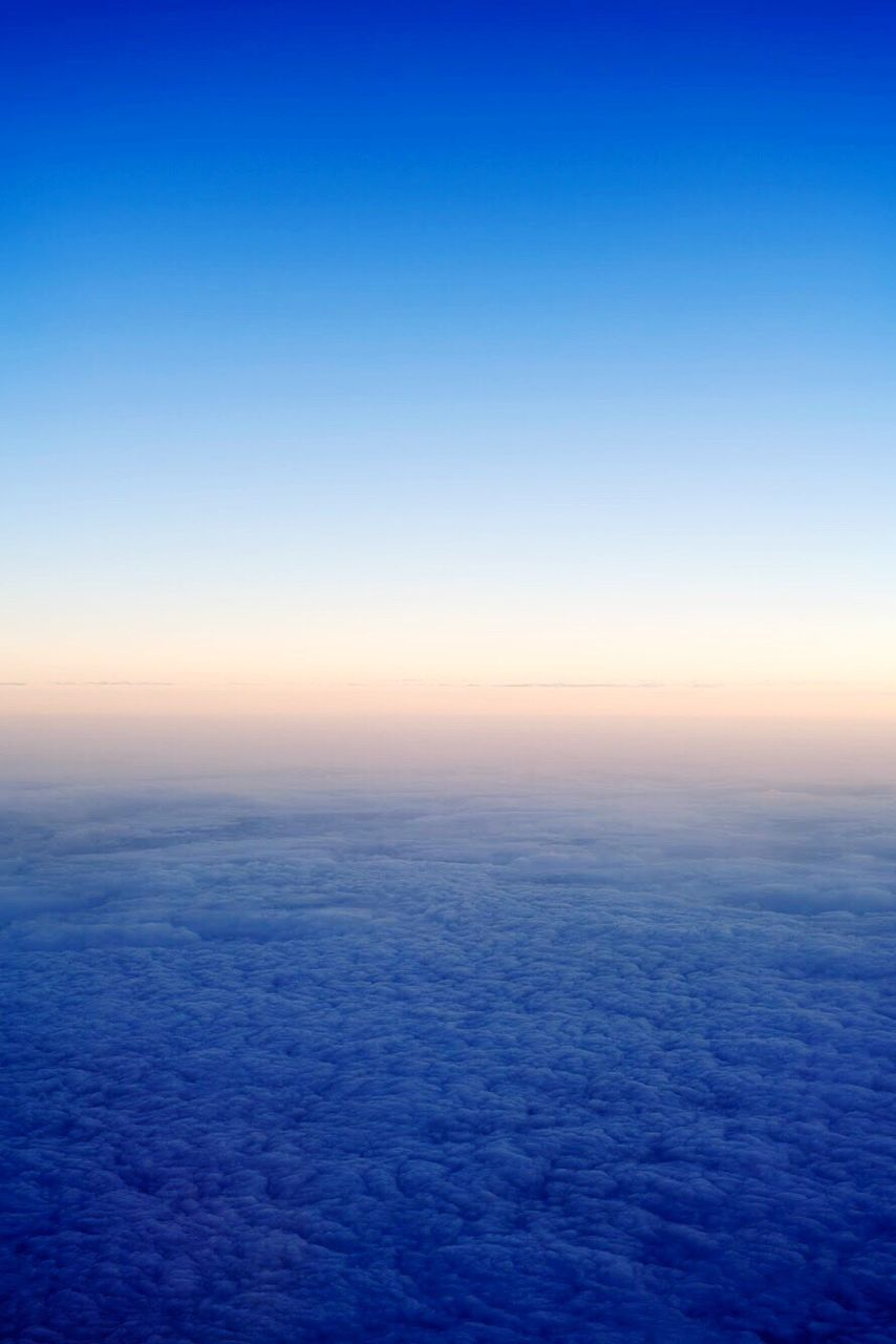 blue, nature, tranquil scene, sunset, scenics, sky, cloudscape, dramatic sky, weather, dusk, sea, space, backgrounds, cloud - sky, beauty in nature, outdoors, horizon, tranquility, no people, wind, horizon over water, sunlight, beauty, fog, the natural world, water, planet earth, day, astronomy, satellite view