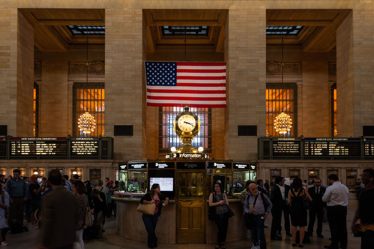 Interior of the Grand Central Station, New York City, United States Patriotism Large Group Of People York Work Window USA Urban United Travel Transportation Train Traditional Tourist Tourism Ticket Terminal Subway Station States Schedule Rush Retro Railway People NYC New York New Movement Motion Metro Manhattan Landmark Interior Inside Infrastructure Grand Flag Fast Destinations Crowd Clock Classic City Central Busy Building Beautiful Architecture American America