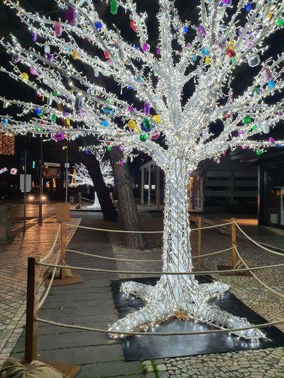 Illuminated christmas decorations on floor at night