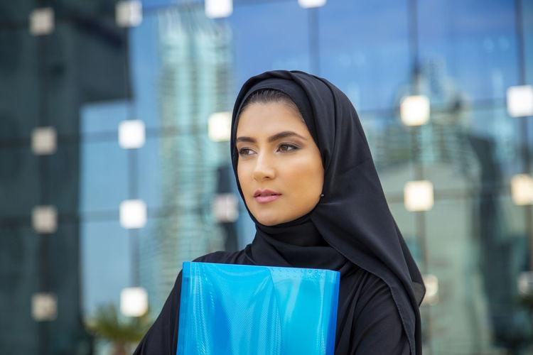 Woman wearing burka in city