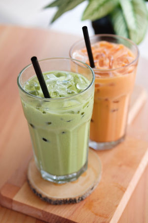 Milk Tea Food And Drink Refreshment Drinking Straw Glass Drinking Glass Straw Household Equipment Drink Food Healthy Eating Table Fruit Freshness Wellbeing No People Focus On Foreground Close-up Wood - Material Indoors  Smoothie Herb Non-alcoholic Beverage