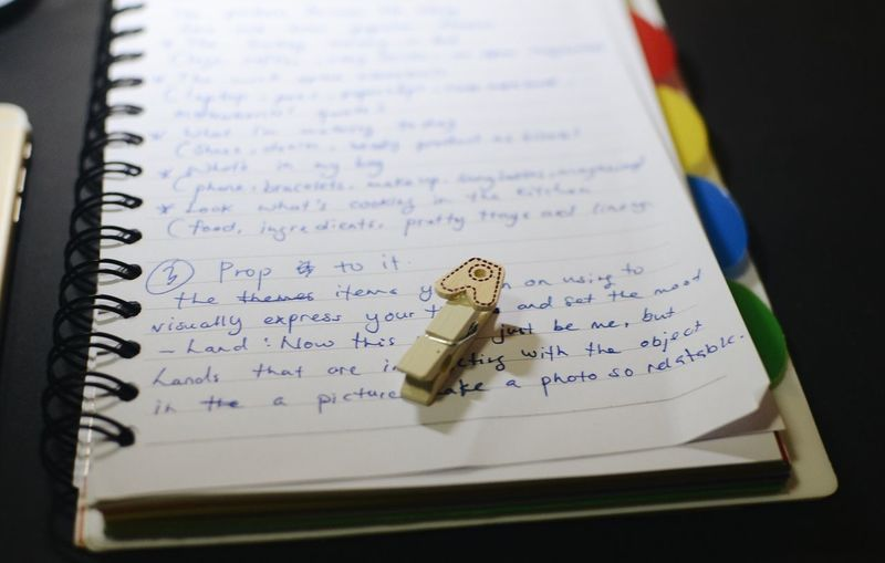 A A Text Indoors  Book Communication Publication No People Western Script Page Selective Focus Jewelry Focus On Foreground Handwriting  Note Pad Close-up High Angle View Pen Ring Education Paper Still Life