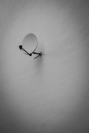 Low angle view of satellite dish on wall