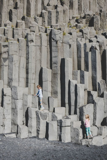 Real People Lifestyles Built Structure People Leisure Activity Day Front View Rock Standing Bazalt Columns And Pillars Beach Volcanic Landscape Reynisfjara
