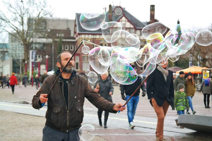 Bubble Man Casual Clothing Happiness Leisure Activity Young Adult Real People Day Outdoors Holding Built Structure City Bubble Adults Only Bubble Wand Sunglasses Adult Multi Colored Friendship Building Exterior Women People Bubbles Bubbles... Bubbles...Bubbles.... Relaxing Moments