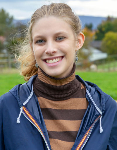 Portrait of young natural woman Portrait Smiling Blond Hair Looking At Camera Happiness Young Adult Emotion Women Cheerful Adult Rain Jackket Nature Fitness Healthy Eating Smile Teeth View Jacket Spring Agriculture Walking Sport Vitality Autumn Seascape