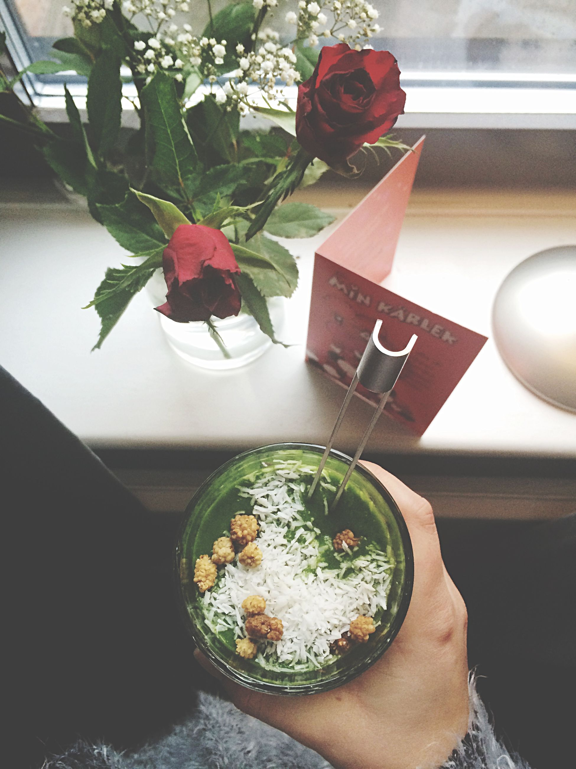 indoors, table, flower, vase, decoration, home interior, freshness, still life, glass - material, high angle view, potted plant, plate, plant, rose - flower, close-up, food and drink, no people, reflection, leaf, transparent