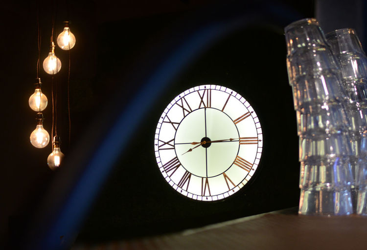 Low angle view of illuminated clock