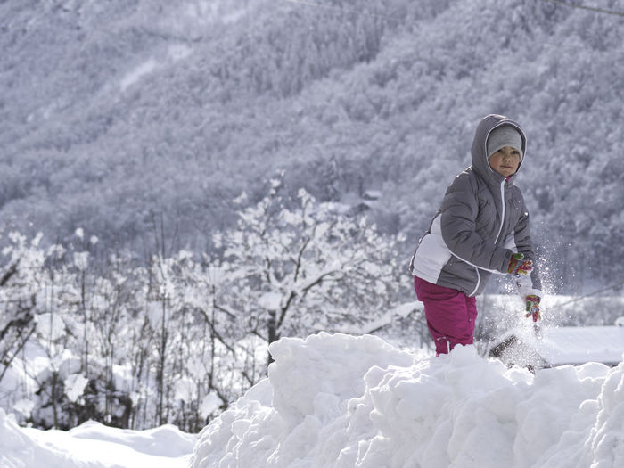 Rear view of person with snow on mountain