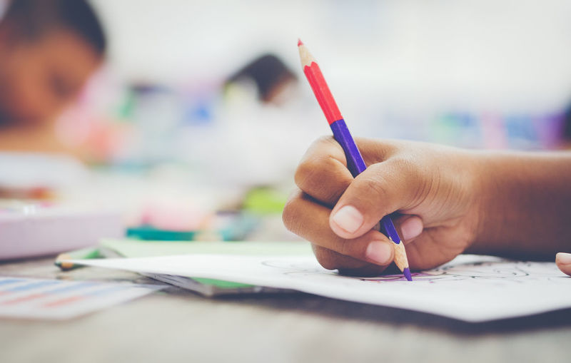 Human Hand Hand Human Body Part One Person Indoors  Child Holding Art And Craft Education Creativity Pen Paper Childhood Selective Focus Learning Real People Writing Drawing - Activity Pencil Finger Colored Pencil Studying School Supplies