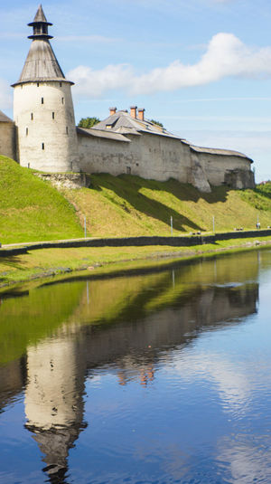 Pskov kremlin Architecture Beauty In Nature Building Exterior Built Structure Day Grass Green Color Kremlin Nature No People Outdoors Reflection Tower Travel Travel Destinations Water