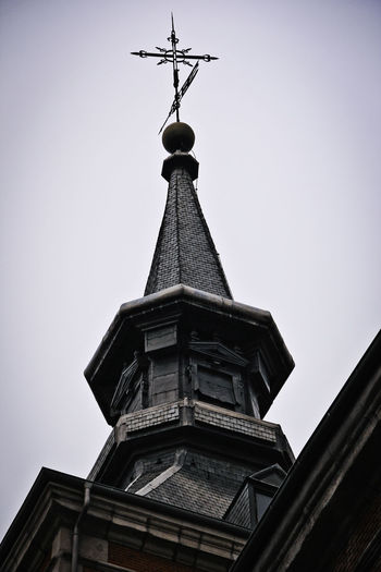 Architecture Building Exterior Built Structure Catholic Church Creepy Cross Gloomy Low Angle View No People Outdoors Religion Religious Architecture Sky