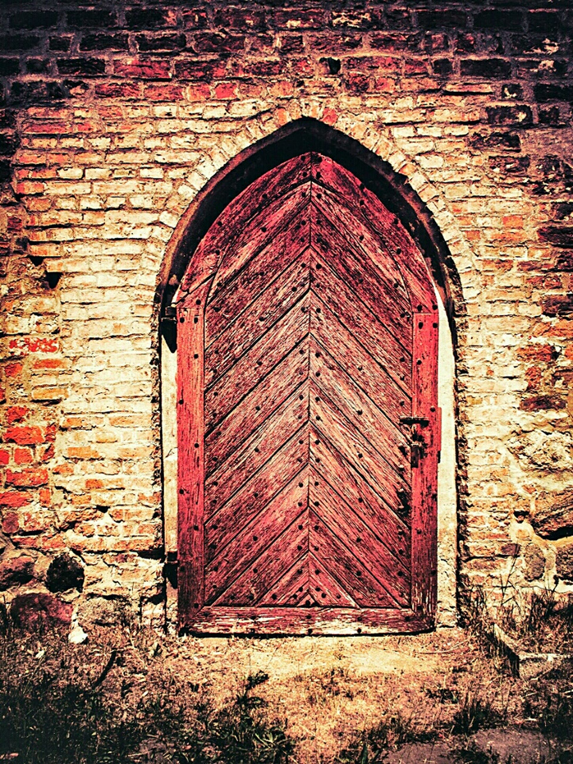 architecture, built structure, building exterior, door, brick wall, closed, arch, red, entrance, window, stone wall, house, wall - building feature, old, protection, day, safety, outdoors, facade, wall