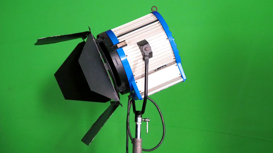 Big studio LED spotlight for video movie or photo film production with green screen background for chroma key technique in post lab process and professional equipment such as tripod and others. Arts Culture And Entertainment Backgrounds Behind The Scenes Colored Background Electric Lamp Equipment Film Industry Filming Green Background Green Color Illuminated Indoors  Lighting Equipment Man Made Man Made Object Metal No People Photographic Equipment Photography Themes Studio Studio Shot Studio; Light; Video; Stage; Lights; Spotlight; Equipment; Film; Background; White; Photography; Photo; Fresnel; Isolated; Spot; Lamp; Movie; Production; Stand; Black; Bright; Camera; Illuminated; Lighting; Backdrop; Art; Scene; Media; Design; Technical;  Technology Television Studio