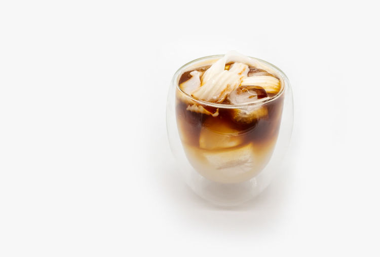 Close-up of coffee against white background