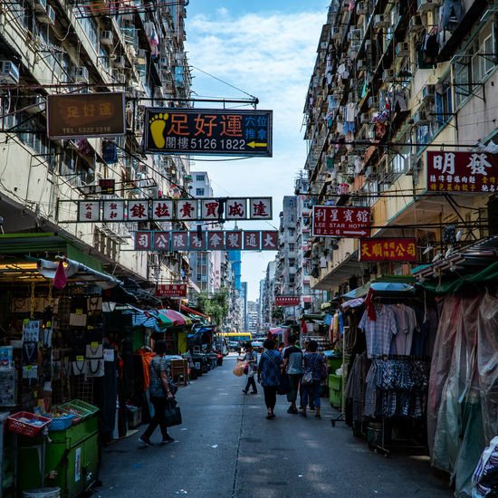 Sham Shui Po in Hong Kong City Architecture Building Exterior Built Structure Street Transportation Real People Group Of People Market City Life Sky Script Day Text Retail  Non-western Script Market Stall Men Store Mode Of Transportation Outdoors Street Market