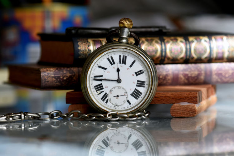 Close-up of pocket watch on table