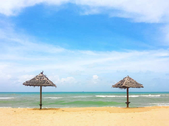 Peaceful scenery of bamboo hut at the beach and blue sky ASIA Beach Life Holiday Relaxing Terengganu, Malaysia Vacations Beach Beauty In Nature Blue Cloud - Sky Day Horizon Over Water Nature No People Outdoors Relax Sand Scenics Sea Shore Sky Thatched Roof Tranquil Scene Tranquility Water
