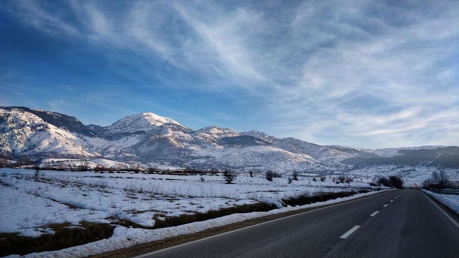 On the move Mountain Snow Cold Temperature Winter Road Snowcapped Mountain Sky Landscape Mountain Range Cloud - Sky