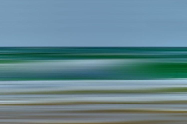 Full frame shot of water against clear blue sky