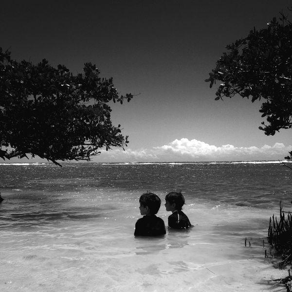Companions. Brothers Twins Enjoying The Sun Kids Beach EyeEm Best Shots IPhoneography NEM Black&white Blackandwhite Shootermag
