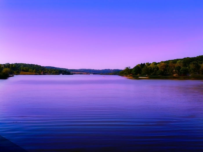 Orfű Lake at sunset in purple lights, in Hungary. Soft focus. 2018 Color Beautiful Hungary Romantic Trees View Visual Creativity Wonderful Background Clear Sky Evening Horizon Over Water Idyllic Lake Landscape Nature Orfű Outdoors Purple Scenics - Nature Sunset Tranquil Scene Tranquility Violet Waterfront Summer Exploratorium