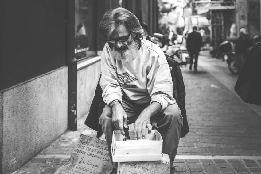 The Homeless Man tries to sell his stuff | Documentary Greece Crisis Black And White The Homeless Condition People Urban Exploration Capture The Moment At The Street The Street Photographer - 2016 EyeEm Awards The Portraitist - 2016 EyeEm Awards The Photojournalist - 20I6 EyeEm Awards