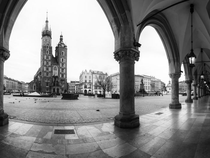 Krakow center Architecture Built Structure Building City Religion Place Of Worship Day Spirituality Travel Destinations Belief Travel Tower Incidental People The Past Architectural Column Tiled Floor Europe Krakow St. Mary's Cathedral Blackandwhite Bw Bw_collection Bws_worldwide BW_photography