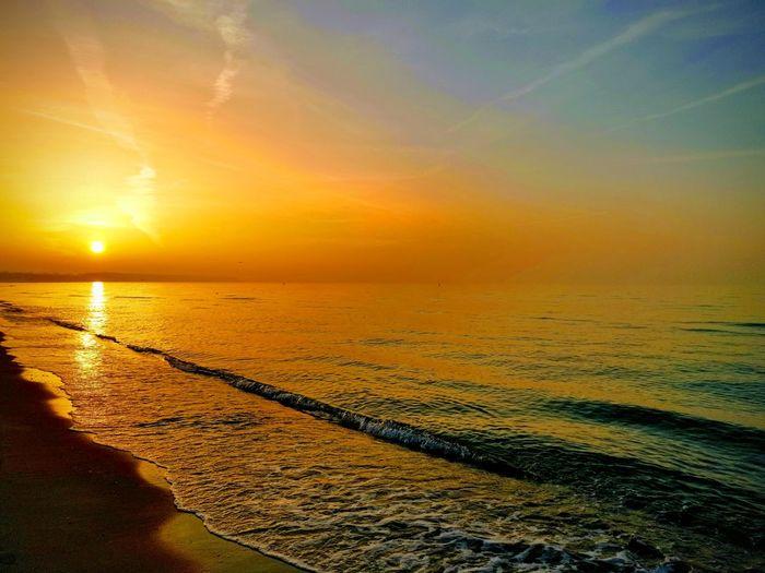Warnemünde Strand ohne Filter Romantic Sky Romantisch Sea Warnemünde Water Sea Sunset Beach Low Tide Sun Gold Colored Summer Sunlight Horizon Romantic Sky Moody Sky Coastal Feature Sunrise Tide Seascape Wave Atmospheric Mood Coast Coastline