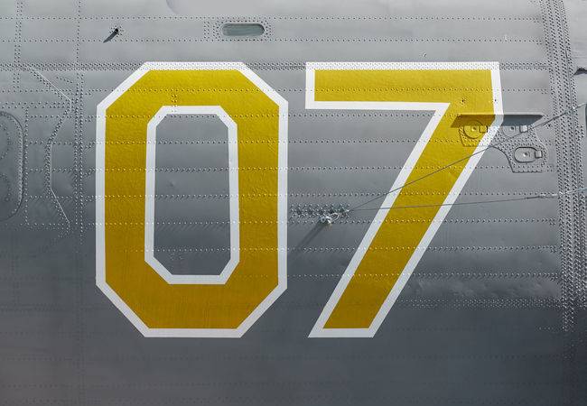 Onboard number of an old military airplane 07 Aircraft Airplane Aviation Background Close-up Fuselage Gray Color Identification Jet Jetliner Metal Military Nobody Number Old Onboard Painted Plane Retro Serial Vintage War Yellow Color
