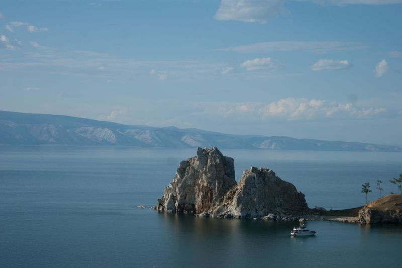 Baikal lake Shamanka rock Baikal Russia Shamanka Rock Baikal Baikal Lake Beauty In Nature Cliff Cloud - Sky Day Mountain Nature No People Outdoors Physical Geography Rock - Object Rock Formation Scenery Scenics Sea Shamanka Sky Tranquil Scene Tranquility Water Waterfront