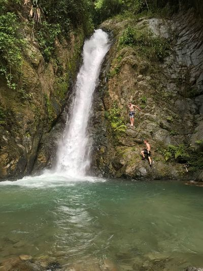 Boys climbing up a waterfall Water Motion Splashing Nature Waterfront Long Exposure Plant Beauty In Nature Tree Real People Waterfall Scenics - Nature Day Leisure Activity Lifestyles People Enjoyment Spraying Flowing Water Outdoors