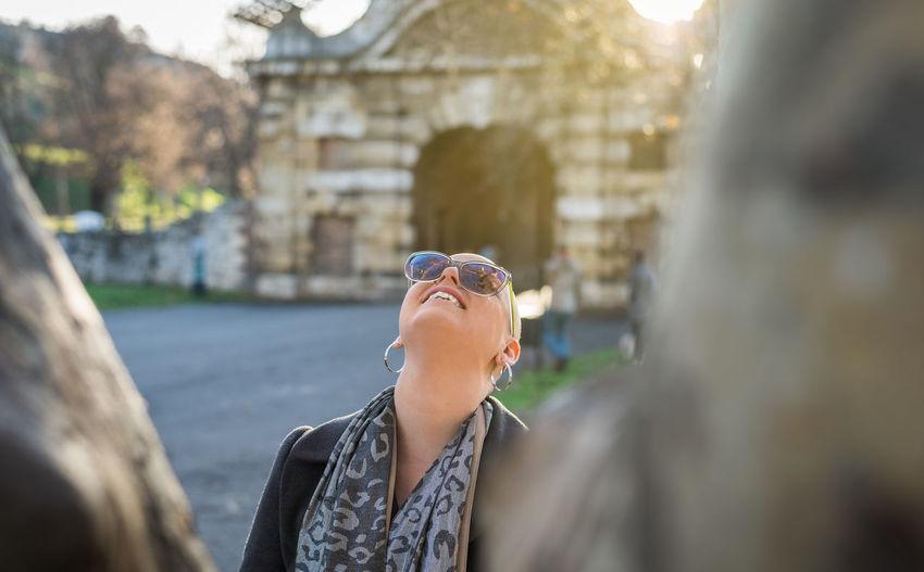 Portrait of happy woman looking away outdoors