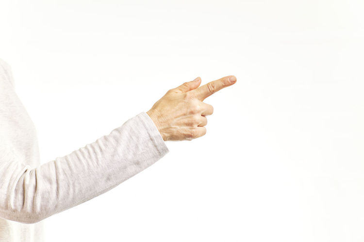 Midsection of man with arms raised against white background